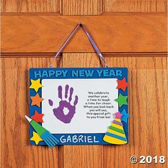 """Handprint """"Happy New Year"""" Keepsake Craft Kit. Celebrate the new year with this fun craft kit. Includes foam pieces, ribbon and a bo. Daycare Crafts, Classroom Crafts, Baby Crafts, Toddler Crafts, Fun Crafts, Crafts For Kids, Classroom Board, Classroom Ideas, New Year's Eve Activities"""