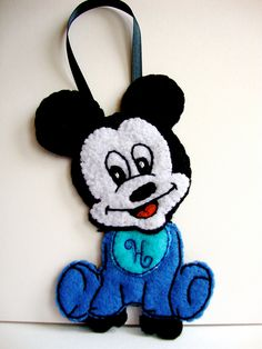 Personalized Disney Baby Mickey Mouse Felt ornament. $18.50, via Etsy. (Personalize Mickey's bib with a short name, monogram, or single letter)
