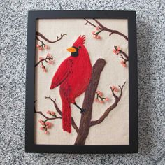 """New on my worktable today! The Cardinal wall art piece has been framed and is ready for photography. 9"""" x 12"""" frame. Techniques used: Hand needle felting, hand embroidery, machine quilting, beading. Copyright 2013, Georgianne Holland"""