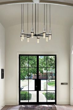 We love hanging chandeliers in entryways. Even in a comparatively small space, there are lots of different modern chandelier ideas for entryways or foyers. Overall, choosing the perfect chandelier must make sense for the space it's in. Keep reading if you are ready to end your confusion about the best modern chandelier to elevate your dining room, bedroom, kitchen, and entryway. Hadley Court Interior Design blog. Chandelier Ideas, Hanging Chandelier, Chandelier Bedroom, Modern Chandelier, Hanging Lights, Chandeliers, Tall Ceilings, Table Sizes, White Home Decor