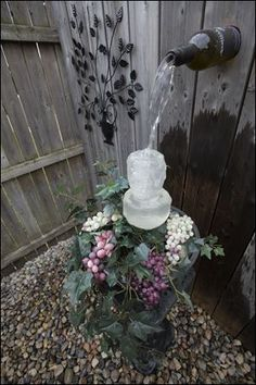 The homemade wine bottle water fountain.