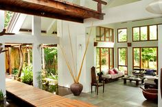 LIVING AREA DETAIL Add high ceilings and create lots of airy, open space in a home. This house also cleverly incorporates a pond that runs alongside an uncovered walkway, cutting through the center of the house. Modern Tropical House, Tropical House Design, Tropical Houses, Filipino Interior Design, Home Interior Design, Interior Architecture, Style At Home, Filipino House, Philippine Houses