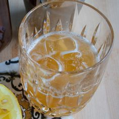 One from the archives! - 1 ½ ounces bourbon - ¾ ounce fresh-squeezed lemon juice - ¾ ounce honey syrup (3 parts warm honey, 1 part warm water) Fill a rocks glass with big ice cubes. Shake up all the ingredients and pour them over the top.