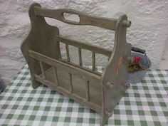 shabby chic magazine rack distressed floral £24.99  Sale: £22.49 Save: 10% off Painted Wooden Vintage Shabby Chic Magazine Rack / Carrier Most charming magazine/book rack. With handle so can also be used as a carrier.  Lovely vintage piece.  This lovely rack has been painted a green/grey colour. Lovely rustic distressed & waxed shabby chic finish. www.countryessence.co.uk