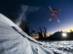Skier Jumping and Grabbing His Skis at Mount Bachelor