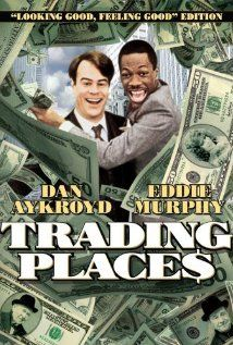 "Trading Places (1983) -- ""A snobbish investor and a wily street con artist find their positions reversed as part of a bet by two callous millionaires"" -- Dan Aykroyd and Eddie Murphy in a classic 80s movie (plus Jamie Lee Curtis as a hooker with a heart of gold) -- if you have not seen it, do so as soon as possible."