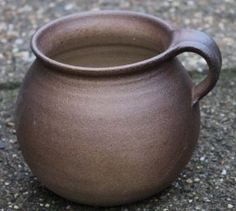 This cup is made after a 10th-11th century original found in Brül. It is completely handmade of the clay from the Rhineland that was traded to The Netherlands, Germany and Italy around the Middle Ages.    The cup has a diameter of 39 cm and its height is 11 cm.
