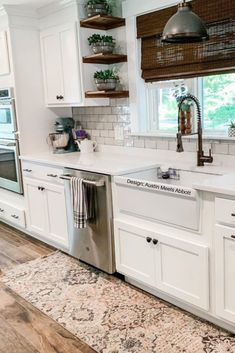 Want to spice up that white backsplash? Pair it with plants, natural wood shelving, and statement accent rug!
