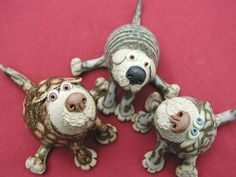 Collectable Miniature Leggy Dog - seated   hand-made pottery from Muggins Pottery in Leicestershire - wedding gifts, birthday presents, christening presents and anniversary gifts.
