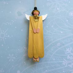 Hand Painted Wooden Angel Ornament Christmas Decoration in Gold Black Hair. $7.00, via Etsy.