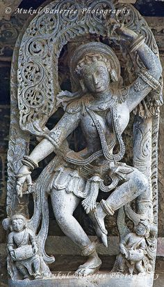 Salabhanjika or Shalabhajika Sculpture (sculpture of a woman, displaying stylized feminine features), Chennakesava Temple, Belur, Karnataka