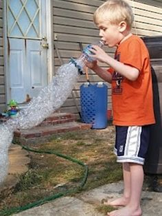To make this bubble blower you need an empty water or soda bottle, a rubber band, a thin wash cloth or piece of fabric, a shallow bowl and dish soap.