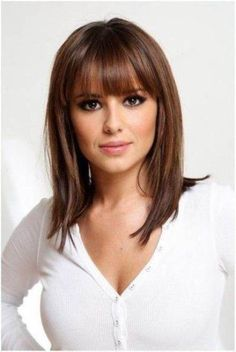 Bangs with face framing layers add style to this long bob