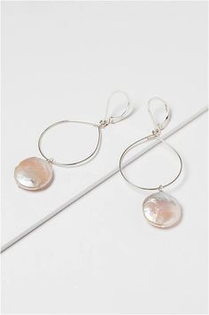 """A modern take on a perennial classic! Lightweight sterling silver hoops are adorned with a single freshwater """"coin"""" pearl. Thoughtfully designed with lever-back style earring hooks so that they will NEVER fall out & get lost! We love this style for a simple wedding earring option, everyday staple, or a fail-proof jewelry gift. Handmade by jewelry artist Alison Jefferies for the luxury jewelry studio J'Adorn Designs. #silverhoops #pearlearrings #designerjewelry Jewelry Shop, Custom Jewelry, Jewelry Gifts, Jewelry Design, Luxury Jewelry, Sterling Silver Hoops, Silver Hoop Earrings, Bridal Earrings, Bridesmaid Jewelry"""