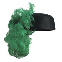 Balenciaga Hat of black silk tulle and satin with a cascade of dyed green ostrich feathers. 1962