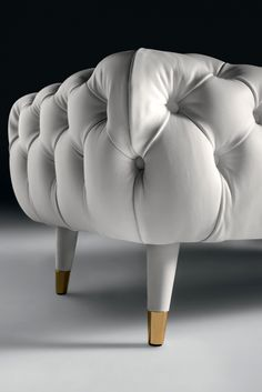 Deeply button upholstered to the highest standard in the finest vibrant white Italian leather with legs in the same beautiful matching leather and finished with the most refined polished brass glides. The divine Leather Designer Button Upholstered Bench is pure elegance, every inch a statement of outstanding style and design. Perfect those who have an eye on the classics but also enjoy the comforts of modern living!