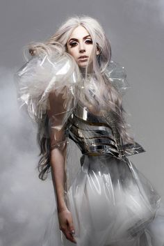 Lady Gaga photographed by Nick Knight for Vanity Fair. Metal corset and pvc gown by Armani Privé