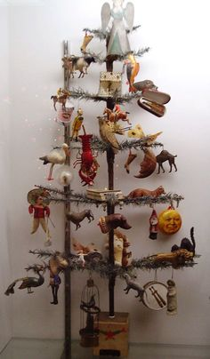 Antique German feather tree dressed in rare German Dresden ornaments