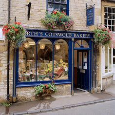 This place beckons me to stay a while...Would just love to have cups of coffee, eat & smell the baked goods & watch the World go by...Bakery Stow-on-the-Wold, Cotswolds, England