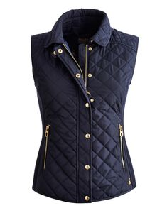 Joules Womens Slim Fit Quilted Vest, Marine Navy.                     When the temperature drops this is the vest to keep close to hand.  Quilted with side rib panels to add definition and shape it's a real slim-fit favourite. Look out for our signature print lining too.