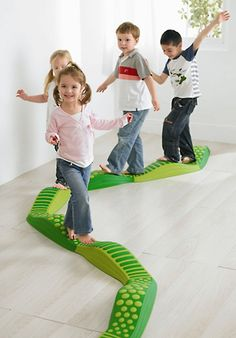 This wavy tactile path requires a great deal of balance and body position awareness to walk across on varying surfaces.