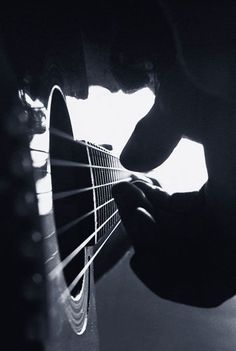 Feel the emotion, the tense silence of expectation, in the brief moment before the musician plucks the first notes....
