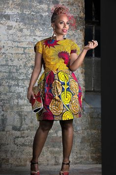 Tulip African print dress is made from beautiful block and Dutch wax. This one of a kind dress is sure to steal the show. Fully lined, invisible