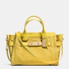 Coach Swagger (17.713.390 VND) ❤ liked on Polyvore featuring bags, handbags, shoulder bags, yellow, yellow leather purse, leather cross body purse, coach purses, leather shoulder bag and coach handbags