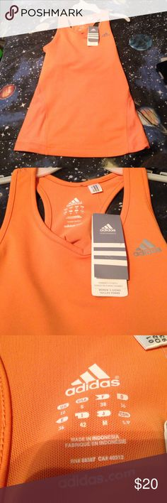 Brand new adidas tank Great workout tank with built in bra. Brand new with tags. Bought it and Never used it. Adidas Tops Tank Tops
