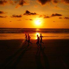 Sunset football on the beach in Puerto Lopez, Ecuador.