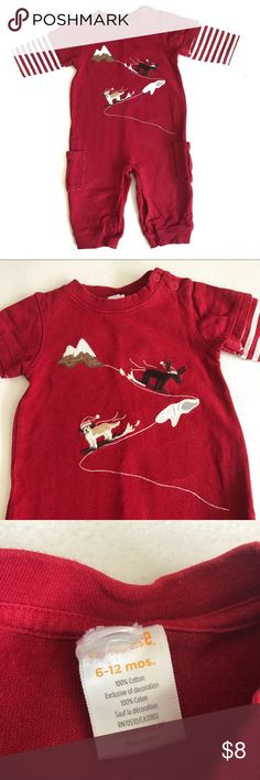 Gymboree Boy Jumpsuit Romper Dog Moose 6-12 Mo This red one piece has a dog and moose in bordered on the front. They are skiing down the mountain with Santa hat on. There are striped sleeves and cargo pockets on the side of the pants. It shows very light wash wear from age, but is otherwise in good condition from a smoke free home. Gymboree Bottoms Jumpsuits & Rompers