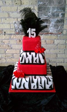 Red and black Quinceanera Cake with feathers