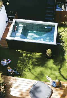 A raised plunge pool was a clever solution to saving space and removing the need for a pool fence. The timber decking and lush greenery is the perfect space to lounge in the sun. pool ideas A Paddington terrace received a modern luxe renovation Small Backyard Pools, Small Pools, Fire Pit Backyard, Backyard Seating, Backyard Decks, Small Pergola, Outdoor Patios, Outdoor Rooms, Outdoor Living