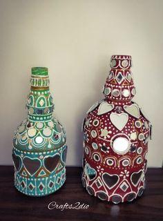 Lippan kaam - the mural art of Kutch ,Gujarat. Plastic Bottle Art, Glass Bottle Crafts, Mural Wall Art, Murals, Painted Glass Bottles, Glass Art Design, Easy Arts And Crafts, Plate Art, Mirror Art