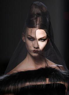 Jean Paul Gaultier.  Model: Karlie Kloss  I love the Morticia Addams-esque veil
