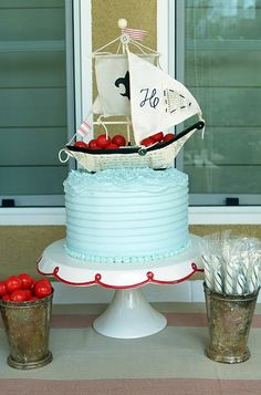 Adorable sail boat cake to go with our Little Sailor collection http://www.thecelebrationshoppe.com/themes/view/little-sailor