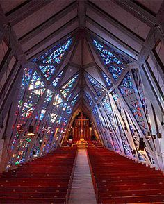 Designed by Wallace K. Harrison, the new sanctuary was dedicated in March 1958. Its shape has been likened to that of a fish- a symbol used in early Christianity. The fish shape is apparent both in the profile and in the floor plan of the structure. Enhancing the unique shape of the church are the outstanding stained glass windows in the sanctuary, containing more than 20,000 pieces of faceted glass and depicting the story of the Crucifixion and of the resurrection; and the 32 foot high…