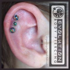 Three healed #helix piercings with #titanium and #blackopal jewelry by #anatometal (at Evolution Piercing)
