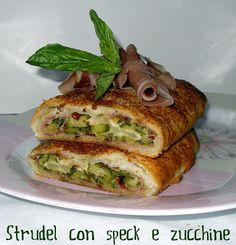 Dolci a go go: strudel con speck e zucchineStrudel salato con speck provola e zucchine 3 zucchine 1 rotolo si sfoglia 80 g di scamorza a fette sottili 100 g di speck Parmigiano
