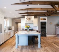 This Home Remodeled By Chris Liles And Austin King Of Rafterhouse Shows Their Signature Design Style With A Great Room Large Kitchen Island Brick