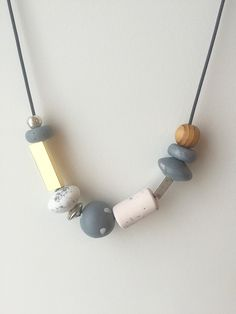 Necklace no. 13 | polymer clay, wood and metal by TheQuietObsession on Etsy https://www.etsy.com/listing/238392270/necklace-no-13-polymer-clay-wood-and