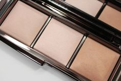 Hourglass Ambient Lighting Palette. Love the idea, not the price. Looks like the trio consists of 3 shades of beige - medium neutral, cool highlight, and dark warm