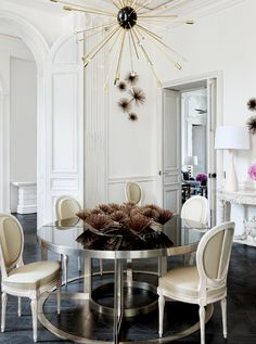 An all white home balanced with dark floors and accessories looks fabulous in Lauren Santo Domingo's Paris duplex.