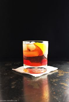 How to make an Old Fashioned drink. Orange, cherries, simple syrup, whiskey/bourbon, and bitters.