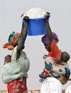 In Mali. Photographer unknown. mothers with babies at work!