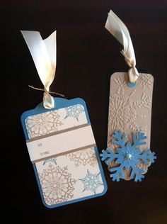 Gift tags featuring Stampin' Up! Snowflake Soiree set, Two Tags die and Northern Flurry embossing folder. Colours are Marina Mist, Crumb Cake and Very Vanilla.