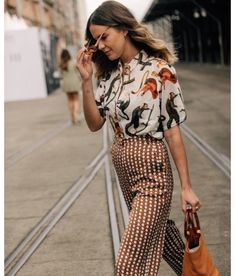 7f386d10bf1 Printed blouse with dotted high waist pants and bucket bag with rings. The  Best Street Style From Australian Fashion Week  Dan Roberts captures the  best ...