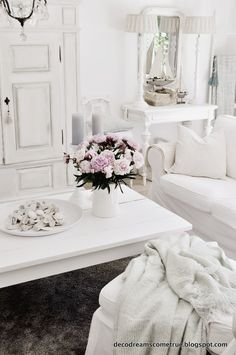 Not a huge fan of the all-white look in one room, but I love the decor Flowers! A hint of light, tea-rose pink.