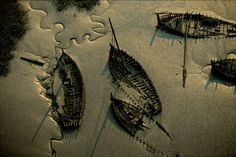 YannArthusBertrand- Cimetière de bateaux de Kerhervy, Lanester, Morbihan, Brittany (47°45'N - 3°20'O).
