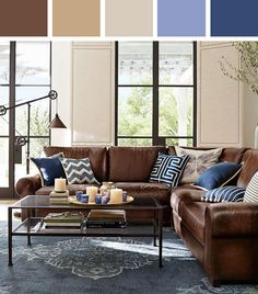 Love how they combine the dark leather couch with brighter colors.